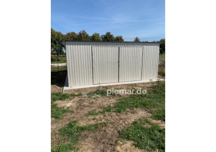Einzelgarage-6x5m-in-Farbe-RAL9010